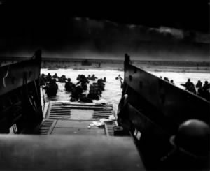 Fold3 Image - Soldiers exit ramp on landing craft on D-Day