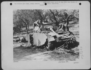 Fold3 Image - Curious Yanks examine one of the many enemy tanks knocked out on the roads to Rome, Italy. These Mark IV tanks were thrown into the battle of Rome to stem the relentless Allied ground offensive and serial pounding by the Mediterranean Allied Air Forces. In the background is a wrecked Nazi duck, a big jeep that can ride water.