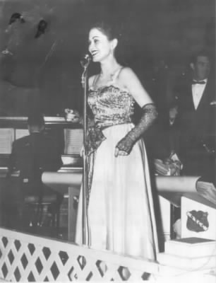 Here is Lola Sugia in 1950, singing with the Wyatt Howard Band in Seattle.