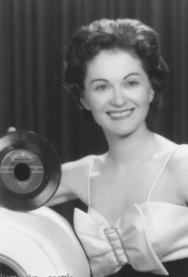 "Lola Sugia, married to song writer Johnny Forrest, posing with hit record, ""Blue Tears"", in 1960.  Blue Tears is scheduled for re-release in 2010 on ""The Best of Golden Crest""."