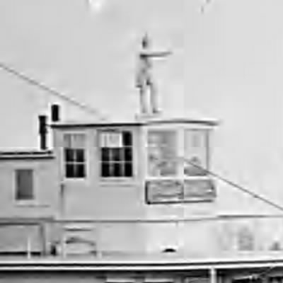 Statue on pilothouse.