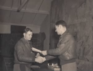 Captain Walter T. Holmes receiving medal from Colonel Johnson