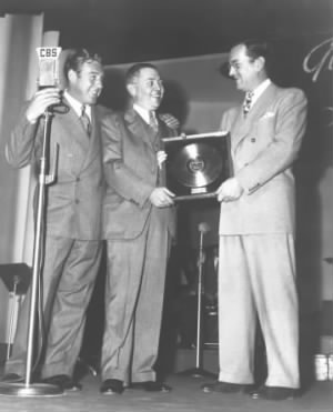 First gold record award presented to Glenn Miller by RCA Victor, 1942