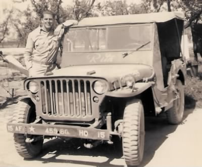 15AF 458 8G  HQ 15 WWII Sgt Howard Campbell with jeep Rita 3x4.jpg - Fold3.com
