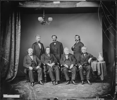 Johnson Impeachment Committee from a photograph by Mathew Brady in the Signal Corps, War Department, Washington. Left to right, Seated: Benjamin F. Butler, Thaddeus Stevens, Thomas Williams, John A. Bingham. Standing: James F. Wilson, George S. Boutwell, John A. Logan.