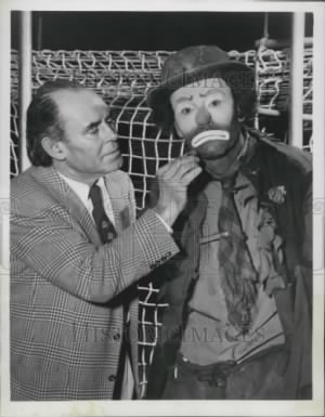 1955 Press Photo Emmett Kelly Adds Frown to Henry Fonda's Face.jpg