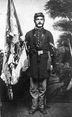 Wm Irvine holding tattered regimental flag from Gettysburg.jpg