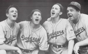 dodger-outfielders-tuck-stainback-buddy-hassett-kiki-cuyler-with-babe-ruth-their-first-base-coach-1938.jpg