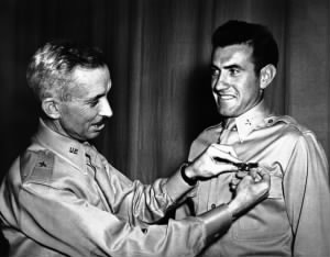 , Brigadier General Isaiah Davies pins a pair of silver bombardier wings on Lieutenant Lou Zamperini.jpg
