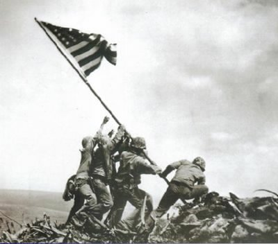 The Marines raise the American flag on Mount Suribachi